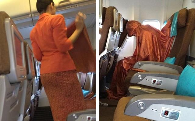 Pramugari Garuda shalat di pesawat